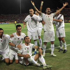 Algeria's players celebrate with fans after teammate Yahia scored a goal against Egypt during their World Cup qualifying playoff soccer match in Khartoum